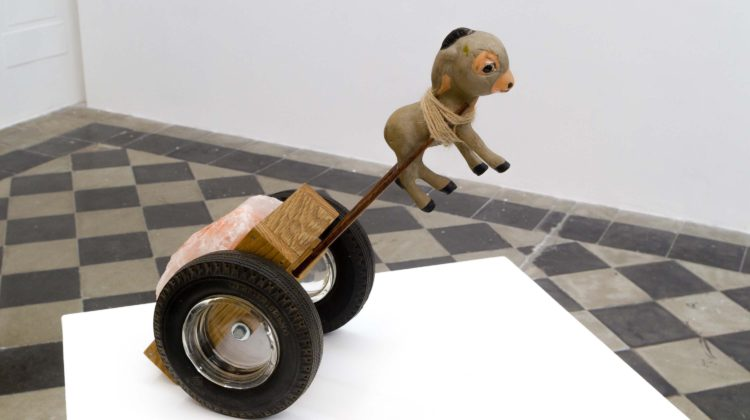 Per-Oskar Leu - Back to the Salt Mines,  2014 1940 Seiberling Latex donkey figure, wooden cart, vintage Seiberling promotional ashtrays, Himalayan salt stone, jute twine