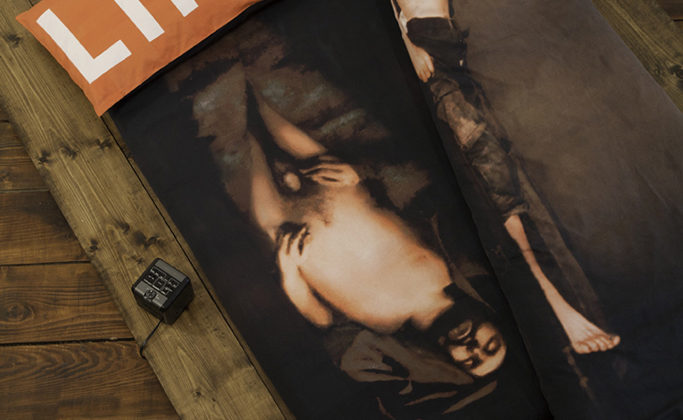 Per-Oskar Leu - Vie et mort de l'image (1995) - 2013 - Manipulated historical photographs, digitally printed on cotton sateen fabric, mounted on bedding. Wooden bed frame, CCTV clock radio, TV monitor