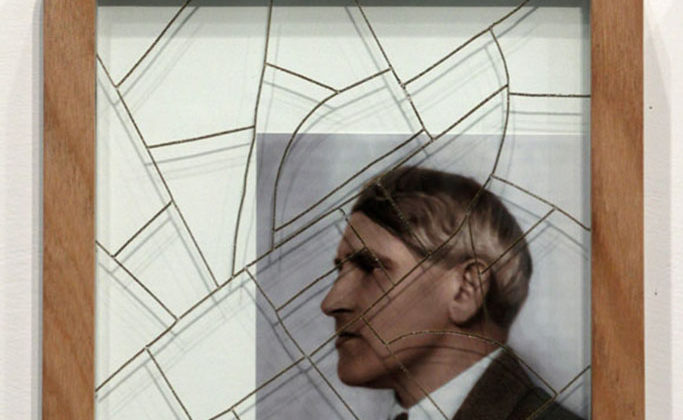 Per-Oskar Leu - The Suitcases of Mr. O.F. (Detail) - 2012 - Laser engraved glass and colorized b/w photographs in wooden frames with suitcase handles Dimensions variable + Single-channel video projection with sound 04min 37sec Edition: 3